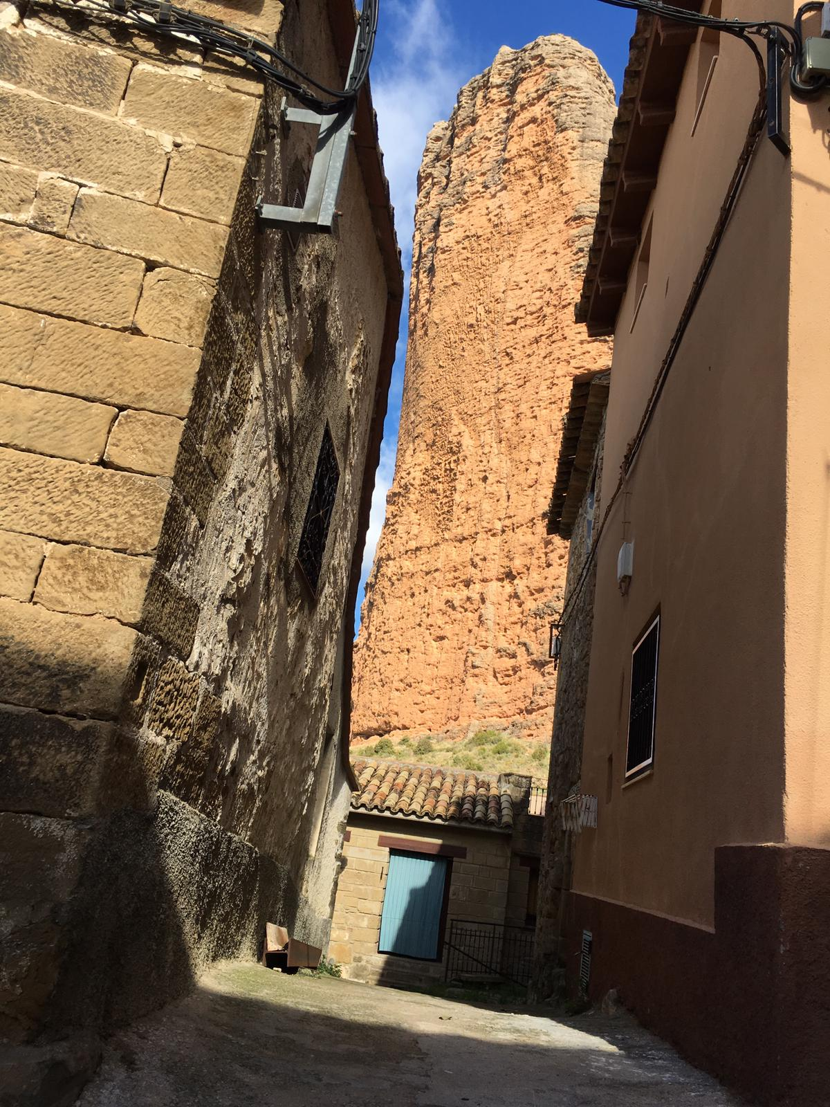 The narrows streets of the village with a stunning view on the walls