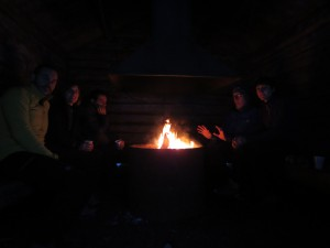 Making fire and having hot Glögg in a cabin in the middle of the woods